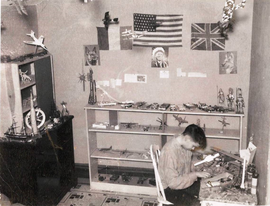 Me working on models in my room c1958.